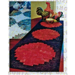 "Zen Table Runner by Jean Ann Wright for Cut Loose Press CLPJAW023 Approximately 18"" x 53"" This pattern features the Creative Grids 8"" Curvy Log Cabin Trim Tool CGRJAW5"